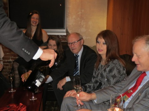 Per Egil serves Karl with a second glass of sparkling wine. From left to right - Wivek, Jacqueline, Magne, Jenny and Karl.